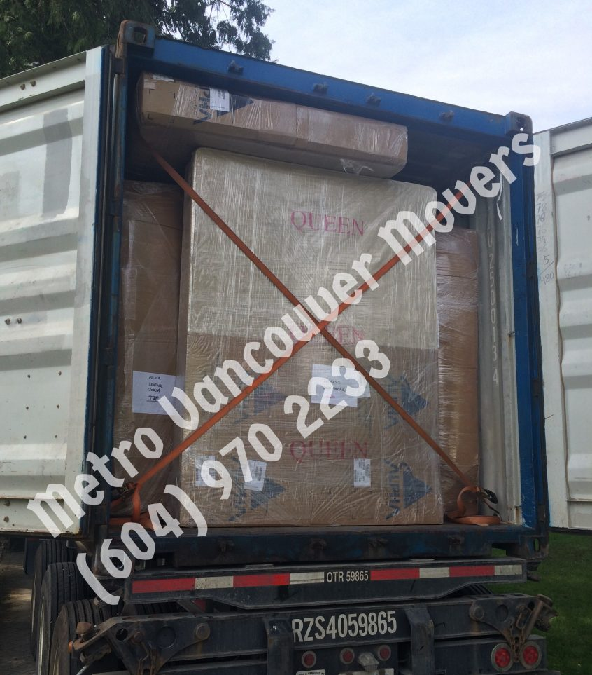 loading trucks: loading a trailer in west vancouver by metro vancouver movers