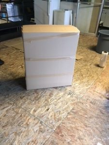 storing furniture without original packaging supplies covering the furniture with cardboard